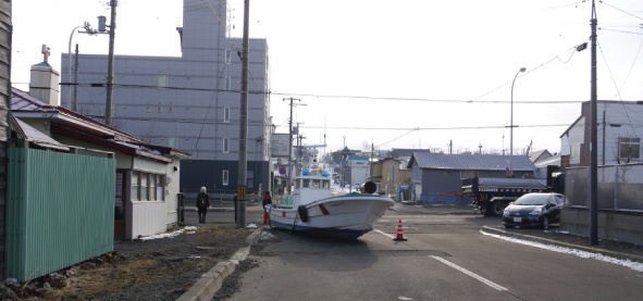 Fig. 1: Example of flood damage (grounded fishing boat in Yayoi town)