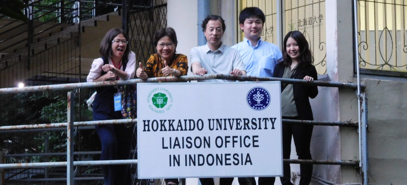 The sign and staff of Liaison Office in Indonesia