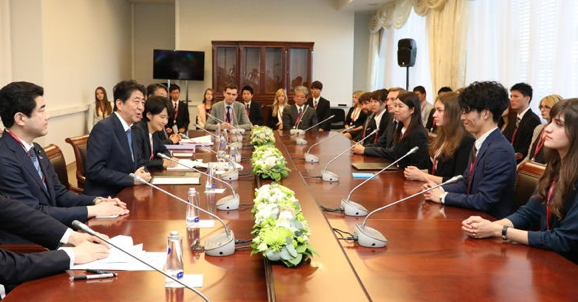 Participants of the Japan-Russia Student Forum meet Prime Minister Abe. Photo edited from the Prime Minister of Japan and His Cabinet.
