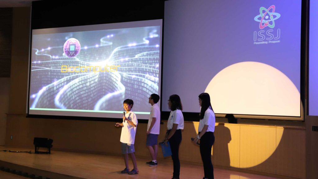 A group of students delivering their final presentation to the audience.