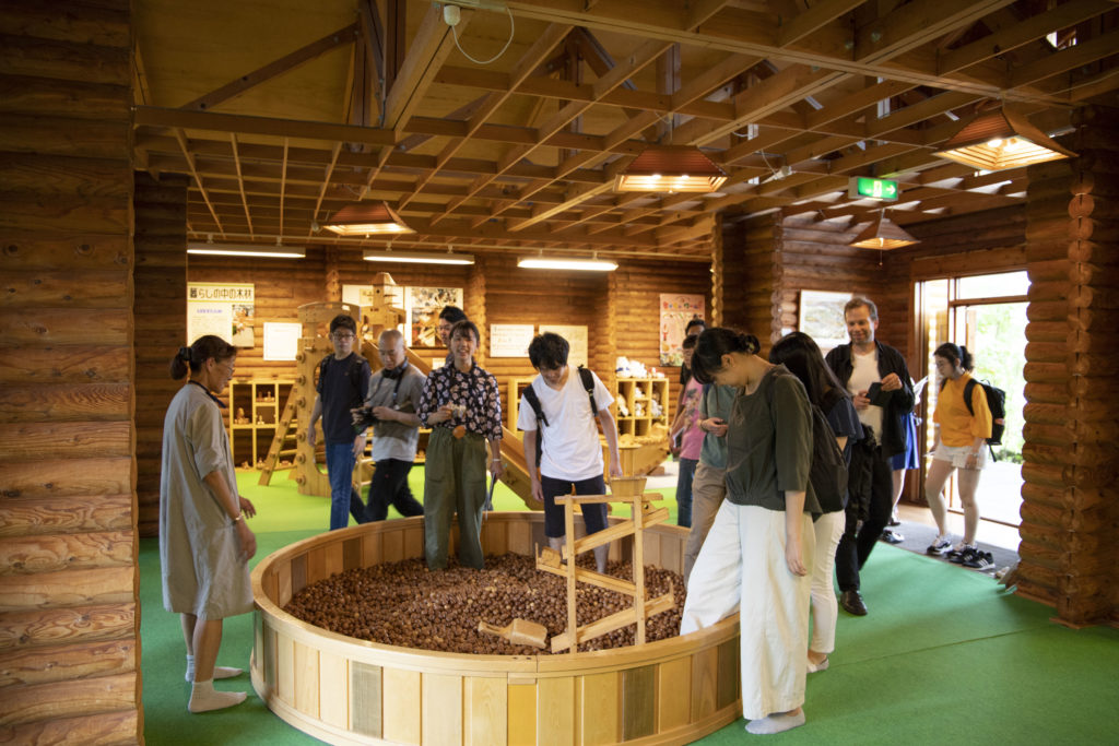 The course participants exploring a nursery primarily made of wood at the Forest Products Research Institute
