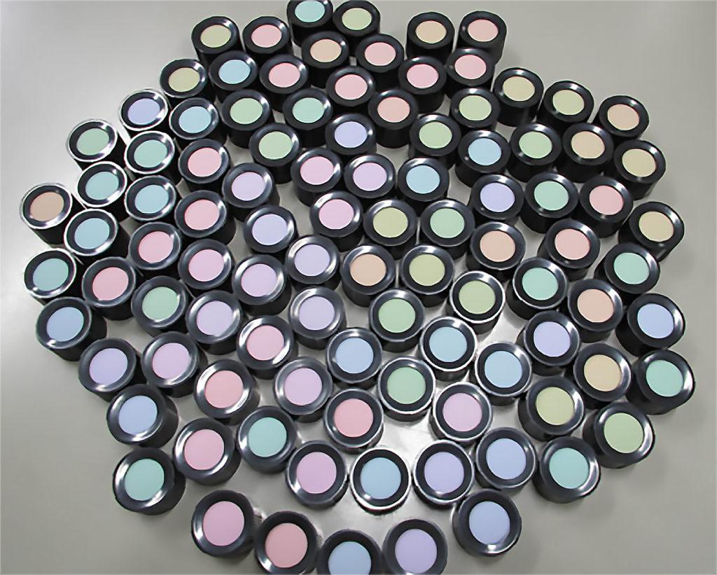 Participants are asked to arrange makeup pots by color gradient.